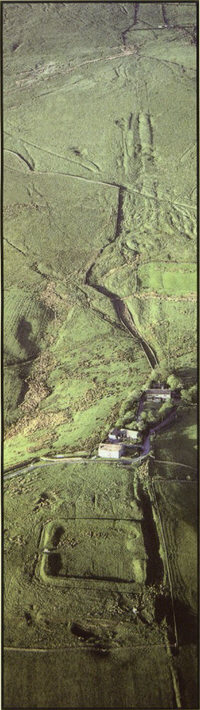 Castleshaw Roman Fort with the Roman road rising towards Standedge